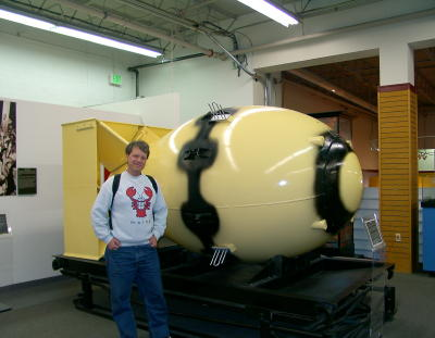 "Here is Mark, next to a ""Fat Boy"" atomic bomb, like the one used in"